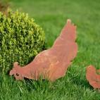 Poule en métal rouillé à piquer